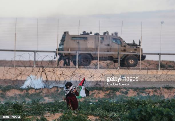 Palestinian holds a Palestinian flag during a protest within 'Great March of Return' demonstrations in Khan Yunis Gaza on January 18 2019