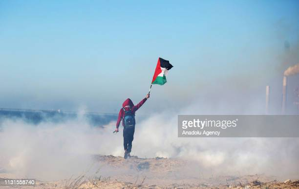 Palestinian holds a Palestinian flag during Israeli forces' intervention within the maritime protests against Israels ongoing blockade of Gaza on the...