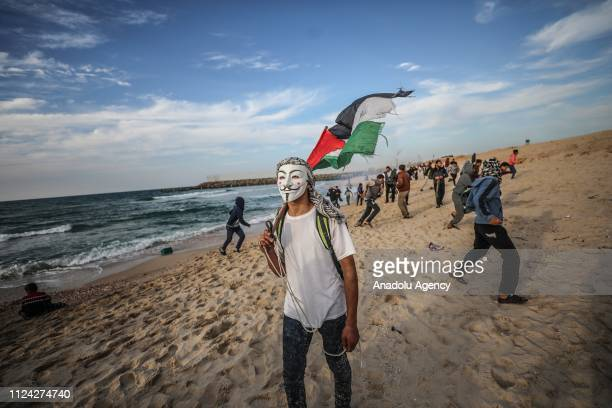 Palestinian holds a Palestinian flag within the maritime protests against Israels ongoing blockade of Gaza in Beit Lahia Gaza on February 12 2019
