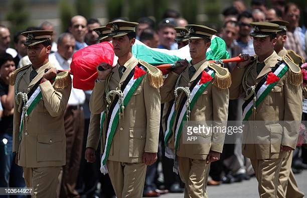 Palestinian honor guard carries the body of former Palestinian intelligence service chief Amin alHindi during a funeral ceremony at the compound of...