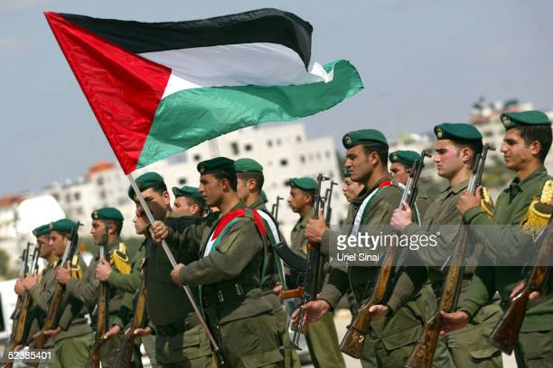 Palestinian honor guard police officers practise at the Palestinian Authority headquarters March 14 2005 in the West Bank city of Ramallah US...