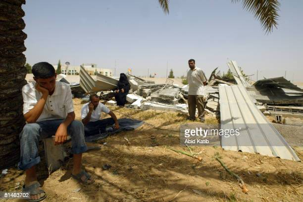 Palestinian inspect the rubble of their destroyed house after an Israeli army operation near Khan Younis June 5 2008 in the southern Gaza Strip A...
