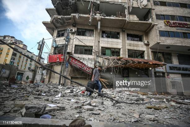 Palestinian inspects the damaged Al-Gussin apartment after Israeli army carried out airstrikes in Gaza City, Gaza on May 5, 2019.