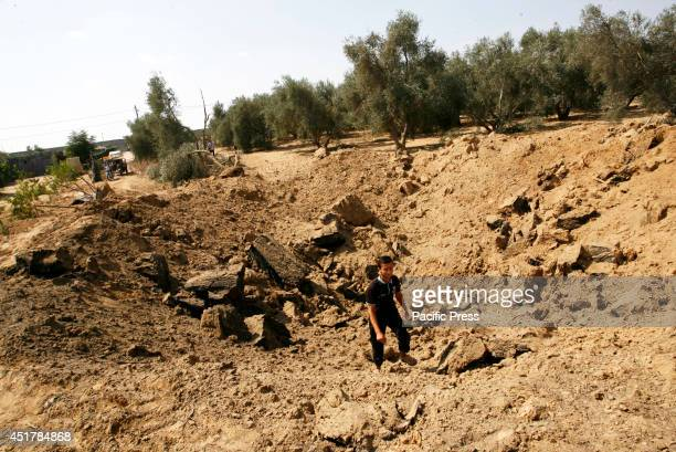 Palestinian inspects the site of an Israeli air strike in Khan Yunis in the southern Gaza Strip Israeli aircrafts attacked 10 sites used by...