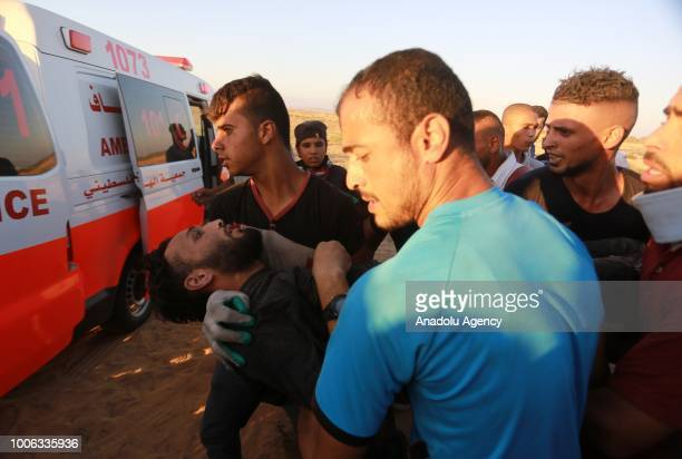 Palestinian is being transported to a hospital after he was injured by Israeli soldiers during Great March of Return demonstration near GazaIsrael...