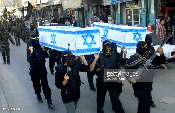 Palestinian Islamic Jihad militants carry a mock coffin representing Israel through the streets of the southern Gaza Strip refugee camp of Rafah, 04...