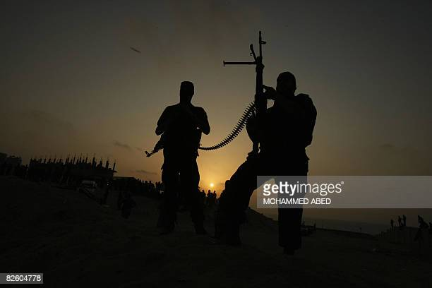 Palestinian Islamic Jihad militants show their skills during a training session in Gaza City at sunset on August 29 2008 Israeli Prime Minister Ehud...