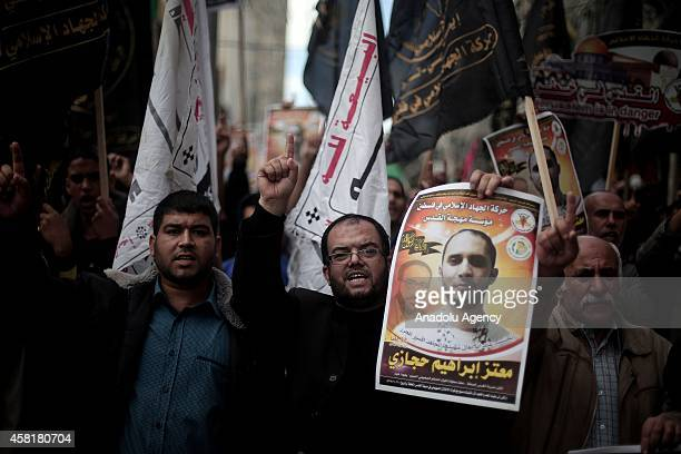 Palestinian Islamic Jihad supporters march during the demonstration against Israeli Government after Friday Prayer in Gaza City Gaza on October 31...