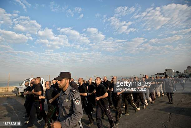 Palestinian Islamist movement Hamas policmen jog along the streets in Gaza City on November 12 three days before the first anniversary of Israel's...