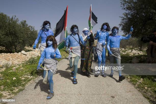 Palestinian Israeli and international demonstators dressed like the Na'vi characters from the blockbuster film 'Avatar' take part in the weekly...