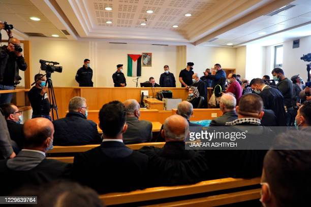 """Palestinian judge Majdi al-Jarar presides over the first session in a lawsuit filed by activists seeking compensation from Britain for the """"wrongs""""..."""