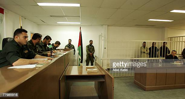 Palestinian Judges lead the first session of the military court while the suspects Hani Mousa Sami Hamoda and Yasser Zanon stand next to their lawyer...