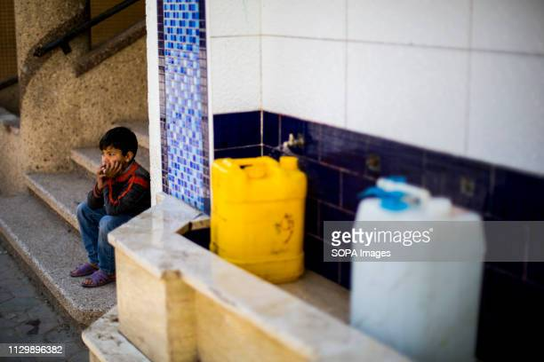 Palestinian kid seen fetching water at the Bureij refugee camp south of the Gaza Strip More and more Gazans are falling ill from their drinking water...