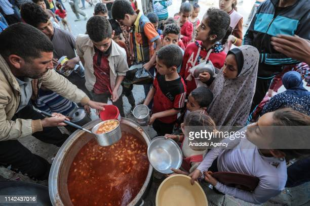 Palestinian kids are seen as they get their iftar meal, distributed by benefactors, in Rafah, Gaza on May 9, 2019.