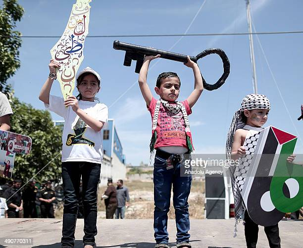 Palestinian kids take part in a rally marking the 66th anniversary of the Nakba Day in Gaza Strip on May 15 2014 Thousands of Palestinians mark the...