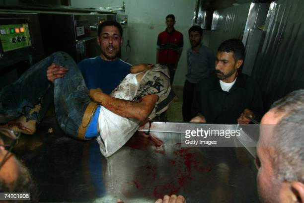 Palestinian killed in an Israeli strike against the home of a Hamas leader is carried away at AlShifa hospital May 20 2007 in Gaza city Gaza Eight...