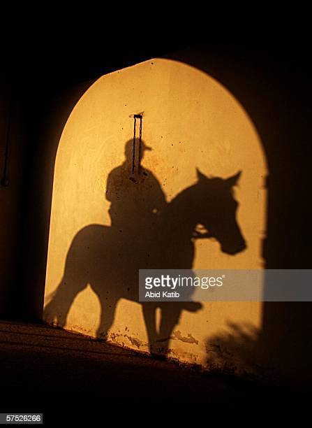 Palestinian knight enters the stables on an original Arabian horse May 3 2006 at the Palestinian knight club in AlSudaneh village in north western...