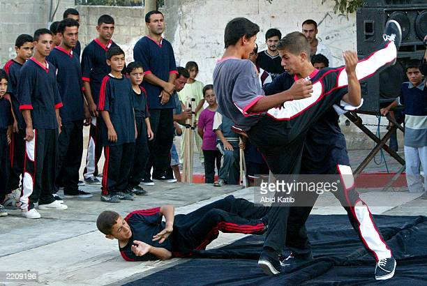 Palestinian Kung Fu students give a demonstration of their martial arts during their commencement ceremony July 26 2003 in the northern Gaza Strip...