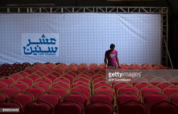 A Palestinian labourer prepares the hall for the screening of '10 Years' at Samer Cinema in Gaza City on August 26 2017 The Samer Cinema in Gaza City...