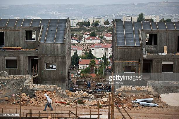 A Palestinian labourer works at a housing construction site on December 4 2012 in the West Bank Jewish settlement of Ariel Israel plans to build 3000...