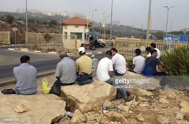 Palestinian labourers arrive for work at the West Bank Jewish settlement of Ariel which was established in 1978 and houses some 16716 people on...