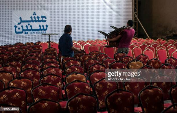 Palestinian labourers prepare the hall for the screening of '10 Years' at Samer Cinema in Gaza City on August 26 2017 The Samer Cinema in Gaza City...