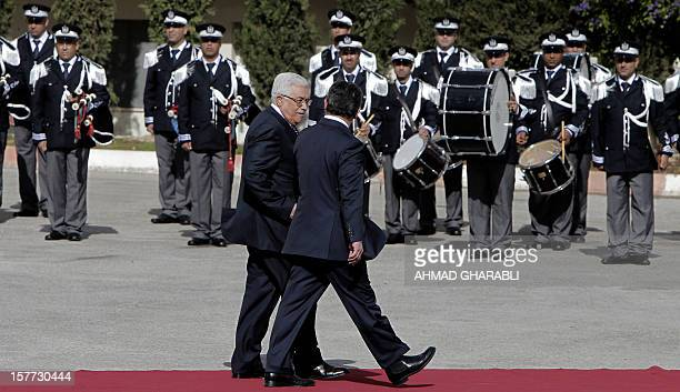 Palestinian leader Mahmoud Abbas and Jordanian King Abdullah II review the honour guard during a welcome ceremony upon the latter's arrival in the...