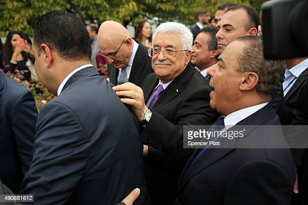 Palestinian leader Mahmoud Abbas is greeted by supporters after the Palestinian flag was raised for the first time at the United Nations headquarters...