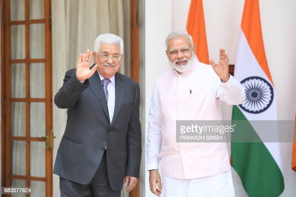 Palestinian leader Mahmud Abbas and Indian Prime Minister Narendra Modi wave prior to a meeting and signing ceremony in New Delhi on May 16 2017...