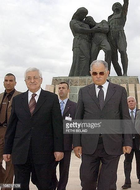 Palestinian leader Mahmud Abbas and Tunisian Defender Minister Kamel Morjane visit the martyrs mausoleum in Sijoumi near Tunis 31 May 2006 Abbas...