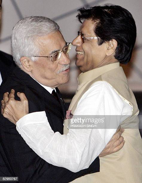 Palestinian leader Mahmud Abbas hugs Indian minister of State for External Affairs E Ahamed after his arrival at the Indira Gandhi International...