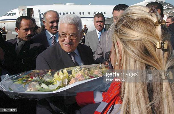 Palestinian leader Mahmud Abbas is greeted by officials upon his arrival at Tunis-Carthage international airport on April 20, 2008. Abbas arrived in...
