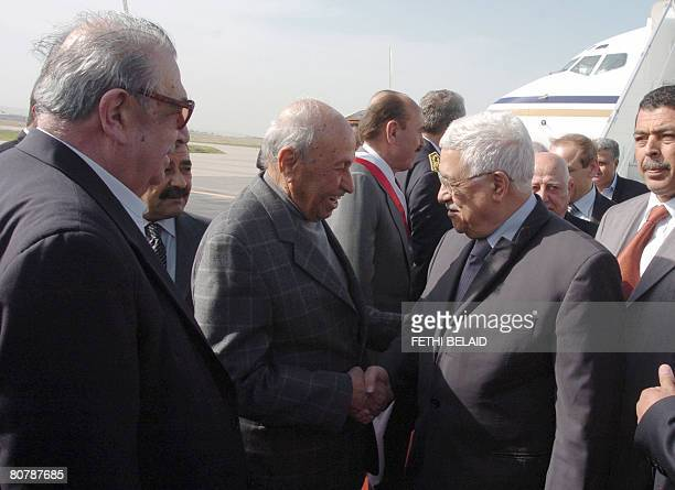 Palestinian leader Mahmud Abbas is greeted by Palestinian FATAH member Ahmed Afana upon his arrival at Tunis-Carthage international airport on April...