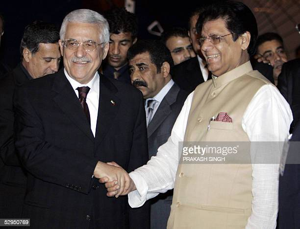 Palestinian leader Mahmud Abbas shakes hands with Indian minister of State for External Affairs E Ahamed after his arrival at the Indira Gandhi...