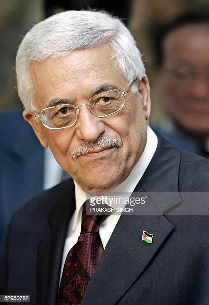Palestinian leader Mahmud Abbas smiles after his arrival at the Indira Gandhi International airport in New Delhi 19 May 2005 Abbas arrived in New...