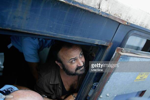 Palestinian leader Marwan Barghouti is taken away under escort September 29 2003 in Tel Aviv Israel after continued proceedings in his trial in the...