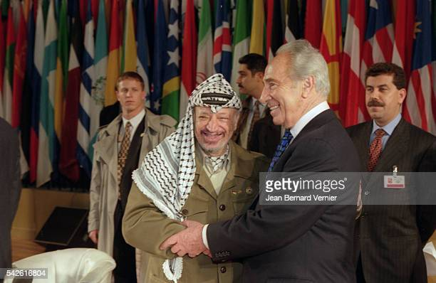 Palestinian leader Yasser Arafat and Israeli minister Shimon Peres attend a UNESCO meeting in 1997 The two were joint winners of the 1994 Nobel Peace...