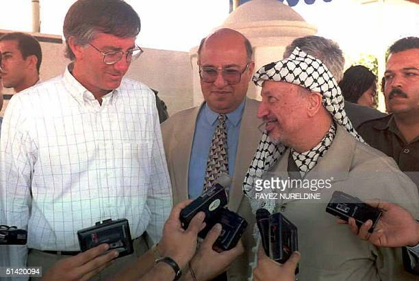 Palestinian leader Yasser Arafat and US Middle East envoy Dennis Ross during a joint press conference 29 August in front of Arafat's office in Gaza...