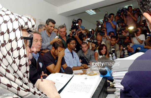 Palestinian leader Yasser Arafat attends a media conference in his compound September 29 2002 in Ramallah West Bank After a personal message from US...