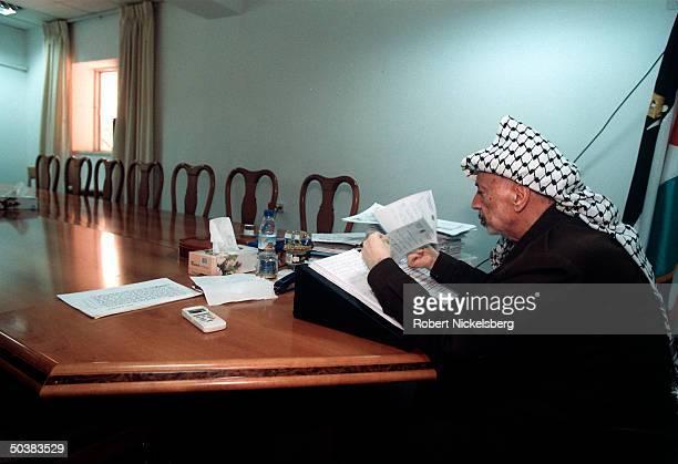 Palestinian leader Yasser Arafat in his office