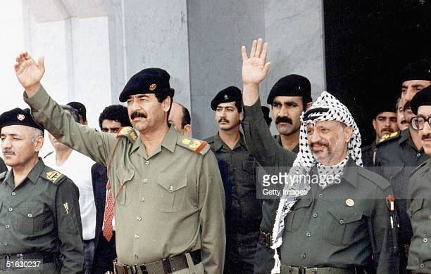 Palestinian leader Yasser Arafat is pictured meeting with Saddam Hussein the former president of Iraq in Gaza City Medics announced on October 31...