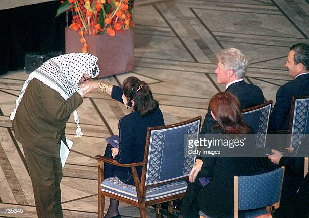 Palestinian leader Yasser Arafat kisses the hand of Lea Rabin during a memorial service for her late husband and Prime Minister Yitzhak Rabin...
