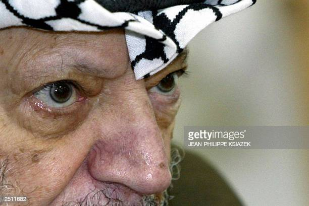 Palestinian leader Yasser Arafat looks on during a meeting with Fatah members 19 September 2003 in the West Bank town of Ramallah. Arafat was under...