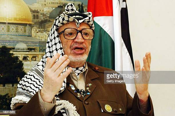 Palestinian leader Yasser Arafat makes a speech during a meeting in his headquarters in the West Bank town of Ramallah on March 5, 2003. Arafat...