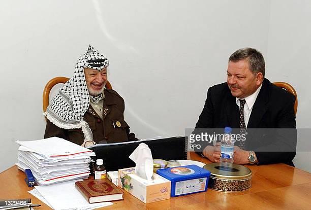 Palestinian leader Yasser Arafat meets with Russian Ambassador Michael Bogdanov May 4 2002 in Arafat''s West Bank office in Ramallah