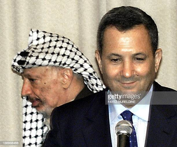 Palestinian leader Yasser Arafat passes Israeli Prime Minister Ehud Barak during their joint press conference following their meeting at the Erez...