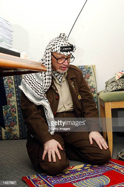Palestinian leader Yasser Arafat prays in his compound September 29 2002 in Ramallah West Bank After a personal message from US President George W...