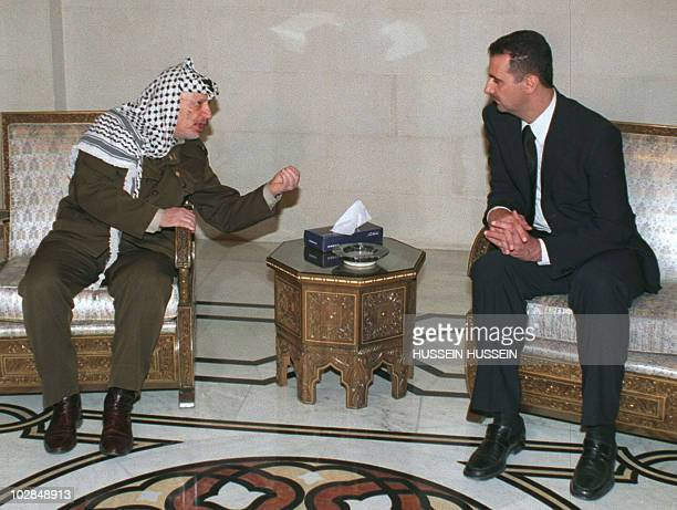 Palestinian Leader Yasser Arafat speaks to Bashar Assad son of late Syrian President Hafez alAssad at the presidential palace in Damascus 13 June...