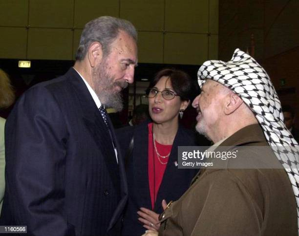 Palestinian leader Yasser Arafat talks with Cuban President Fidel Castro during the opening session of the World Conference Against Racism August 31,...