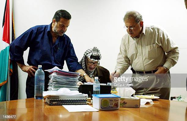 Palestinian leader Yasser Arafat works in his compound on the second anniversary of the intifada or uprising September 28 2002 in Ramallah West Bank...